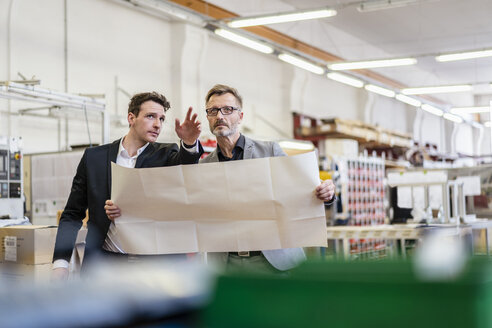 Two businessmen discussing plan in a factory - DIGF06268
