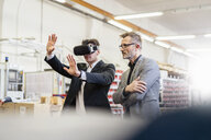 Two businessmen with VR glasses in factory - DIGF06271