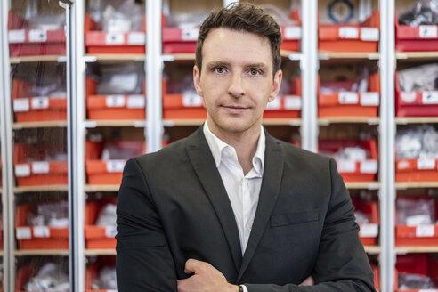 Portrait of confident businessman in factory - DIGF06277