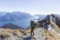 Italy, Como, Lecco, woman on a hiking trip in the mountains above Lake Como - MRAF00376