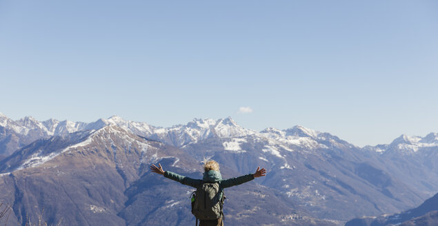Hiker woman enjoys the view of the mountains. - MRAF00388