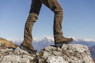 Italy, Como, detail of hiking boots on the rock - MRAF00394