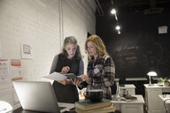 Creative businesswomen using digital tablet brainstorming in office - HEROF30492