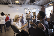 Businesswomen networking and celebrating milestone toasting champagne flutes - HEROF30507