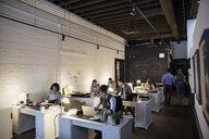 Creative business people working in open plan office - HEROF30528