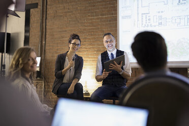 Designers with microphone and digital tablet leading conference meeting - HEROF30540