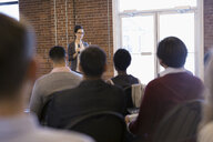 Businesswoman with microphone leading conference meeting - HEROF30546