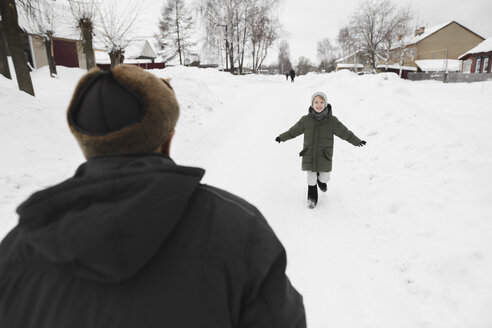 Happy grandson running to his grandfather in winter - EYAF00026