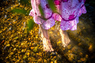 Feet of girl standing in a brook - SARF04178