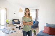 Portrait of smiling woman at home - SBOF01907