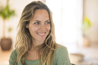 Portrait of smiling blond woman at home looking sideways - SBOF01943