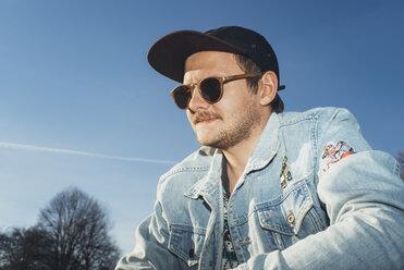 Portrait of a young man under blue sky - GCF00248