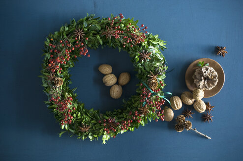 Selfmade Advent wreath, box twigs, rosehip, star anise, walnuts and almonds - ASF06313