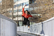 Young contemporary dancer on a footbridge - JRFF02861