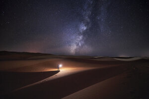 Morocco, Man with light at night in Merzouga desert - EPF00569