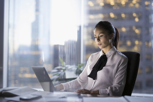 Female lawyer working late at laptop in urban office - HEROF30803