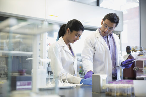 Scientists with digital tablet working together in laboratory - HEROF30977