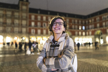 Spain, Madrid, Plaza Mayor, portrait of happy young woman - WPEF01383