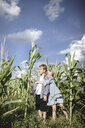 Boy and girl standing in a cornfield - EYAF00033