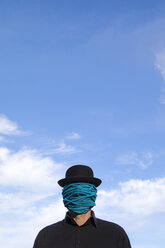 Man wearing bowler hat with rope wrapped around his face - PSTF00359