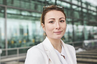 Portrait of confident young businesswoman in front of a building - PNEF01380