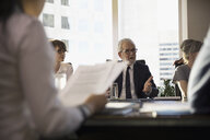 Male lawyer talking and gesturing in conference room meeting - HEROF31241