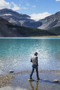 Canada, Jasper and Banff National Park, Icefields Parkway, man at lakeside - EPF00580