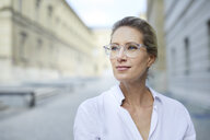 Portrait of confident woman wearing glasses and white shirt in the city - PNEF01457