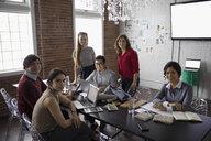 Portrait smiling hispanic designers brainstorming in conference room - HEROF31549