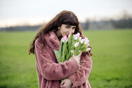 Young woman with bouquet of tulips and pink coat - FLLF00079