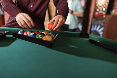 Close-up of billiards player arranging balls on table - ZEDF02014