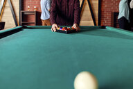 Close-up of billiards player arranging balls on table - ZEDF02032