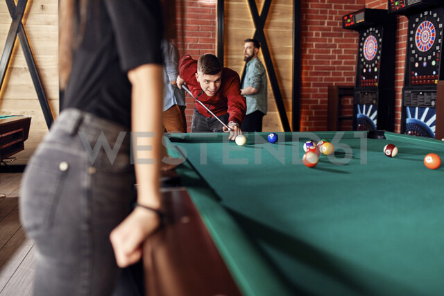 Friends playing billiards together - ZEDF02035