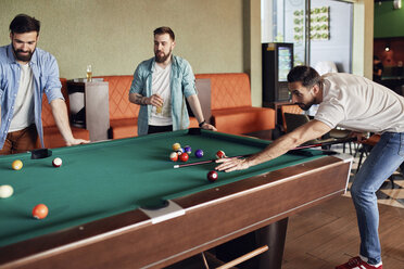 Friends playing billiards together - ZEDF02044