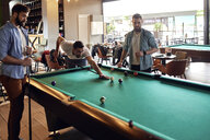 Friends playing billiards together - ZEDF02047
