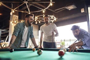 Friends playing billiards together - ZEDF02050