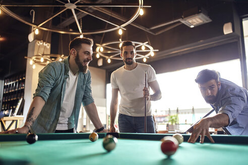 Friends playing billiards together - ZEDF02050