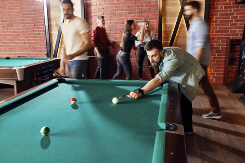 Friends playing billiards together - ZEDF02053
