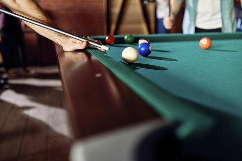 Close-up of man playing billiards - ZEDF02059