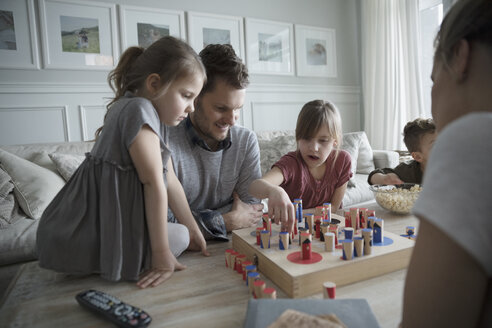 Young family playing game in living room - HEROF32144