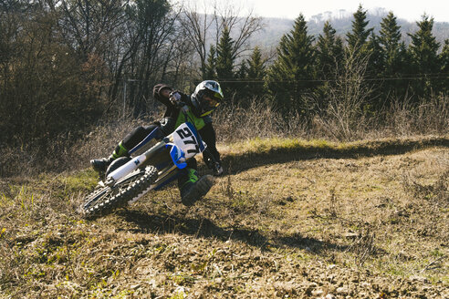 Motocross driver riding on circuit - FBAF00361