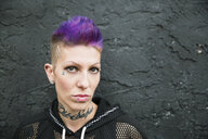 Portrait tough cool young woman with purple hair - HEROF32277