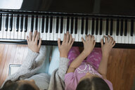 Overhead view sisters playing piano - HEROF32367