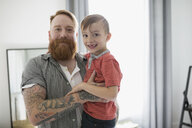 Portrait smiling father holding son - HEROF32526