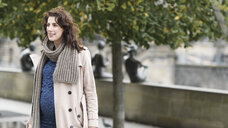 Portrait of pregnant woman wearing trenchcoat and scarf in autumn - EYAF00063