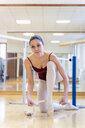 Ballet dancer putting on shoes - FMOF00470