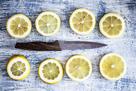 Two rows of lemon slices and a kitchen knife - GIOF05892