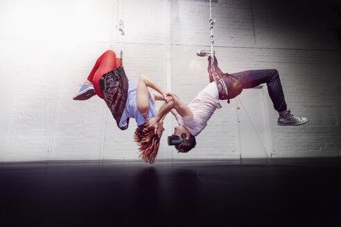 Modern aerialist dancers hanging - FSIF03821