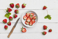 Strawberries, chopped in white bowl - GWF06025