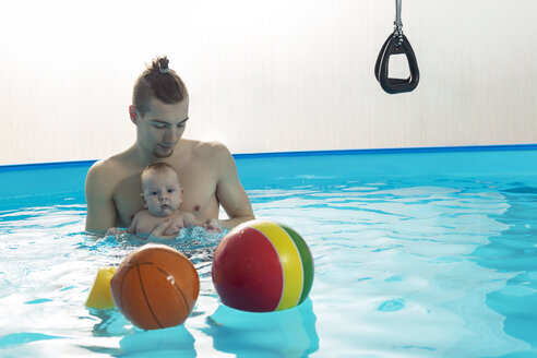 Baby swimming, father and son in swimming pool - VGF00251